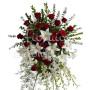 Fiori a domicilio: cuscino funebre di rose rosse e gigli bianchi